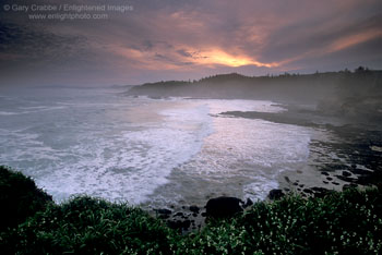 Sunrise light through storm clouds at Rocky Creek, Oregon