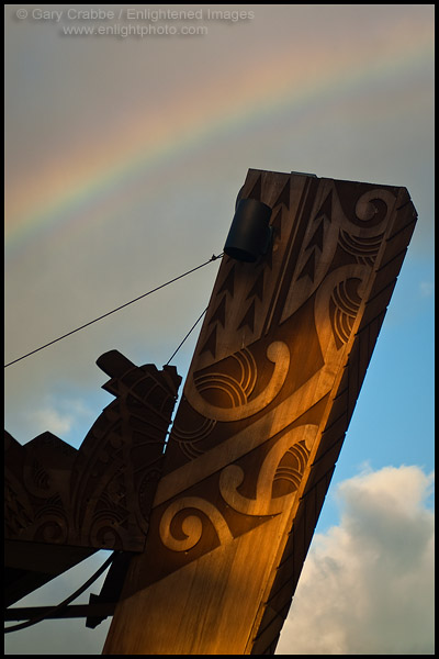 Picture: Rainbow over Polynesian motif wood carving, Paradise Cove, Ko Olina, Oahu, Hawaii
