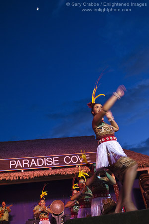 Hula Dancers underneath an evening moon while performing at the Paradise Cove Luau, Ko Olina, Oahu, Hawaii