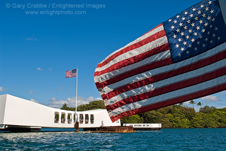 The US Flag flying above the USS Arizona Memorial at Pearl Harbor, Oahu, Hawaii