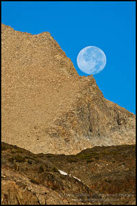 Photo: Full moon resting on rock precipice near Tioga Pass, Mono County, California