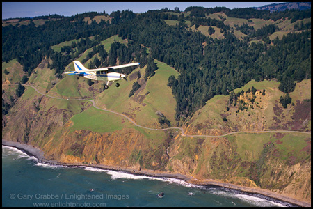 Photo: Single engine plane (Maule) over Highway One along the Sonoma County coast, north of Jenner, California