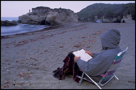 Person reading on the coast on a cool evening, Montana del Oro State Park, San Luis Obispo County, California