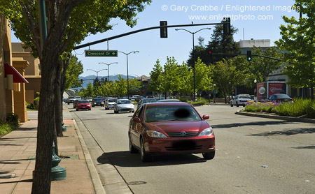 Car driving on suburban street in downtown Pleasant Hill, California