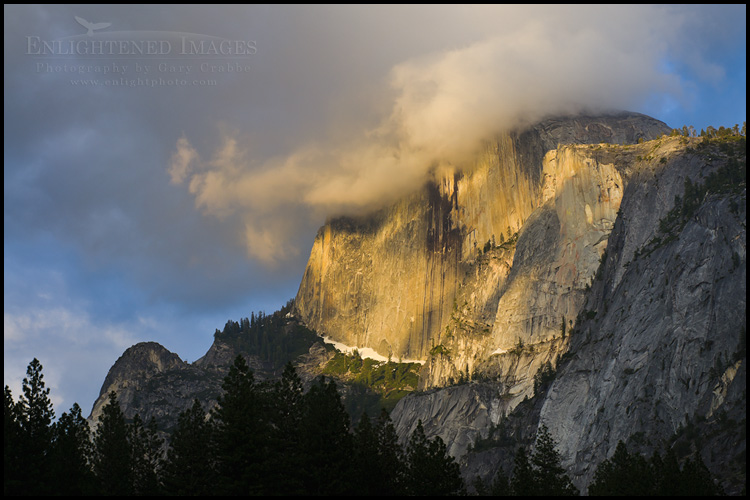 Image: Storm clouds shroud the summit of Half Dome at sunset, Yosemite National Park, California