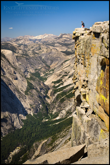 Image: Hiker checking out the view from the summit of Half Dome, Yosemite National Park, California