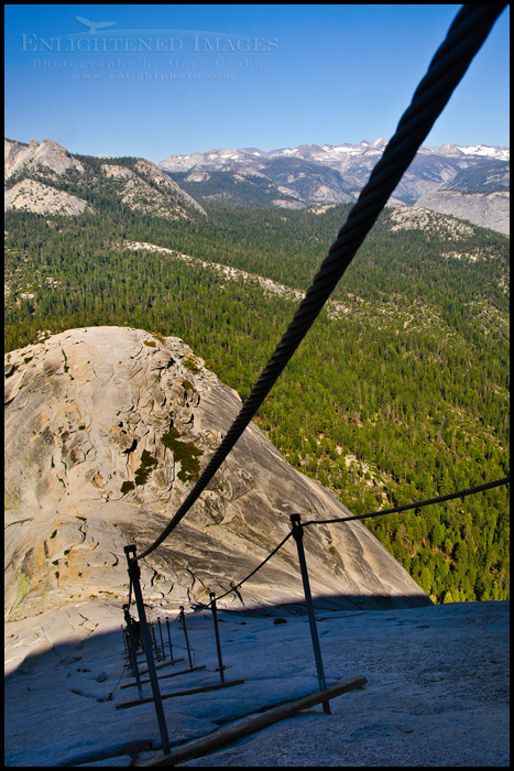Image: The view while looking down, descending the cables from the summit of Half Dome, Yosemite National Park, California