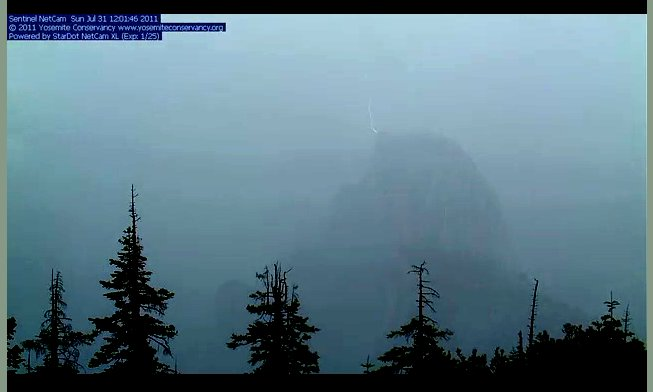 Image: Lightning strikes the summit of Half Dome as seen from one of the Yosemite Web Cams, Yosemite National Park, California