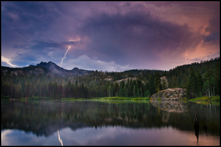Image: Lightning bolt striking the Sierra Buttes reflected in Packer Lake, Sierra County, California