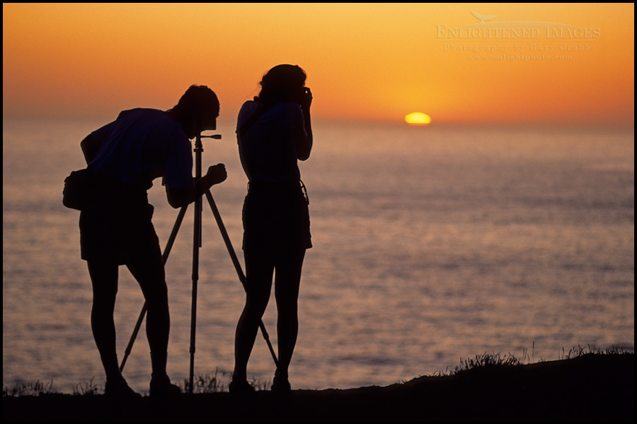 Image: Photographer couple shooting the sunset together from the Marin Headlands, California