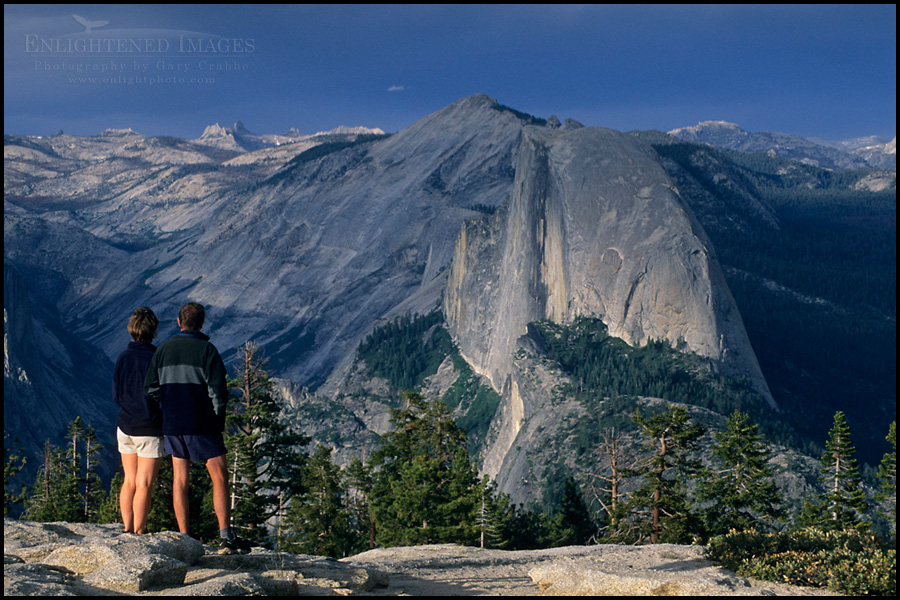 Image: Hikers looking towards Half Dome and Tenaya Canyon from atop Sentinel Dome, Yosemite National Park, California