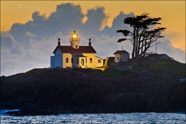 Image: Storm clouds at sunset passing behind Battery Point Lighthouse, Crescent City, California