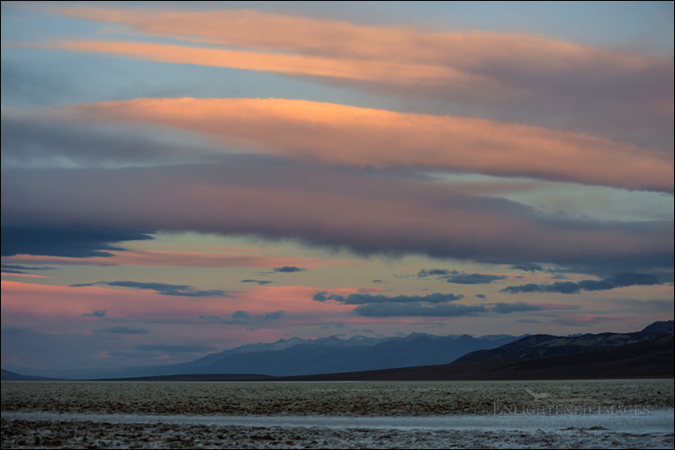 Image: Morning light on clouds over the Badwater Basin, Death Valley National Park, California