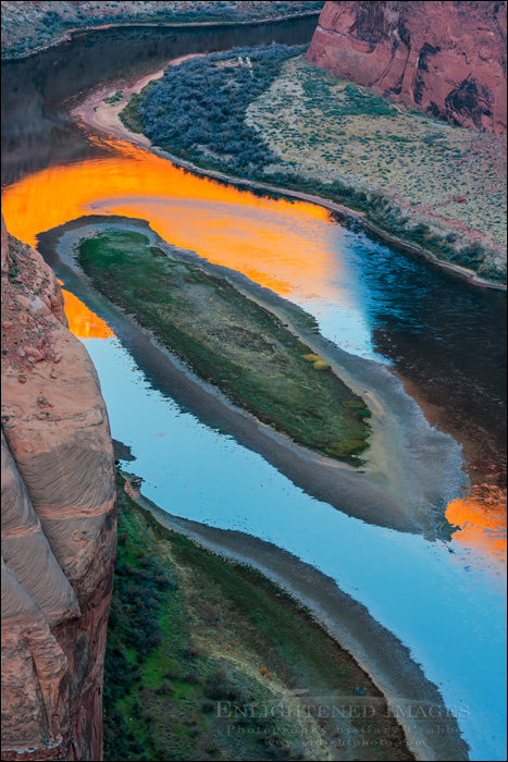Image: Photographers standing on the rim of Horseshoe Bend at dawn over the Colorado River, near Page, Arizona