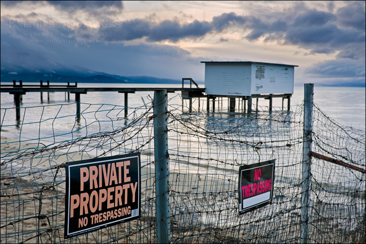 Image: No trespassing signs and fence along the shore of Lake Tahoe, South Lake Tahoe, California