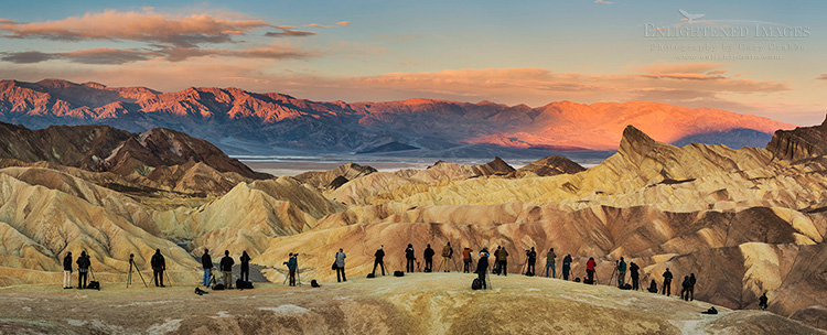 Image: Panoramic photo of photographers lined up to shoot the sunrise at Zabriskie Point, Death Valley National Park, California