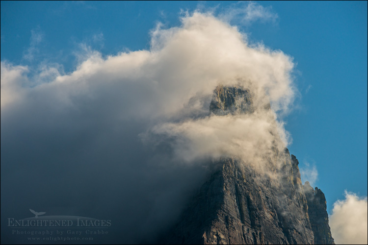 Image: Storm clouds envelope a mountain peak in Glacier National Park, Montana