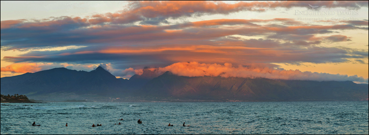 Image: Morning light on clouds over surfers along the North Shore of Maui, Hawaii
