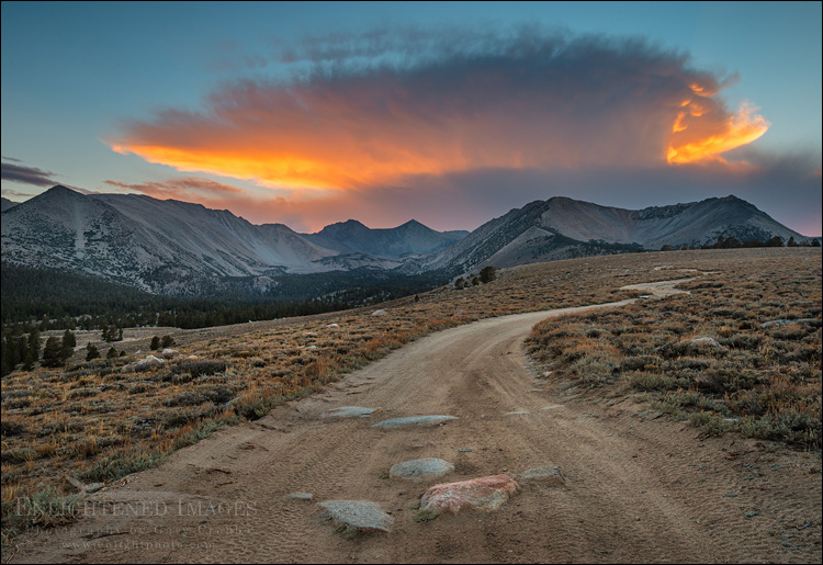 Image: Sunset light on cloud over dirt road in the Inyo National Forest, Inyo County, Eastern Sierra, California