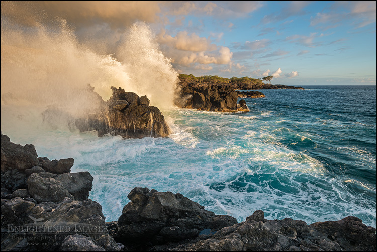 Image: Waves breaking against lava rocks on the coast at The End of the World, North Kona District, Big Island, Hawaii