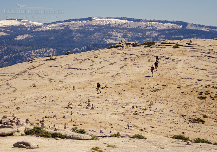 Image: Hikers and cairns along the open granite top of Half Dome, Yosemite National Park, California