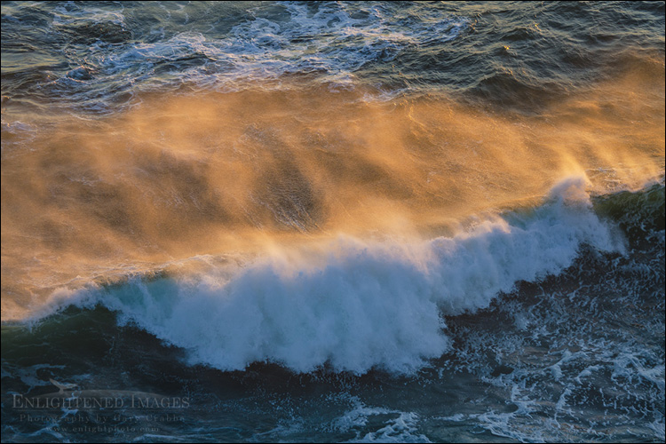 Image: Sunset light illuminates the spray off a breaking wave along the coast at Point Reyes National Seashore, Marin County, California