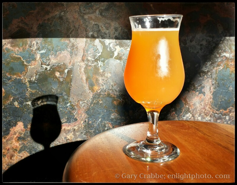 Image: A cold glass of IPA beer sitting in the sunlight at the Hop Grenade, Concord, California