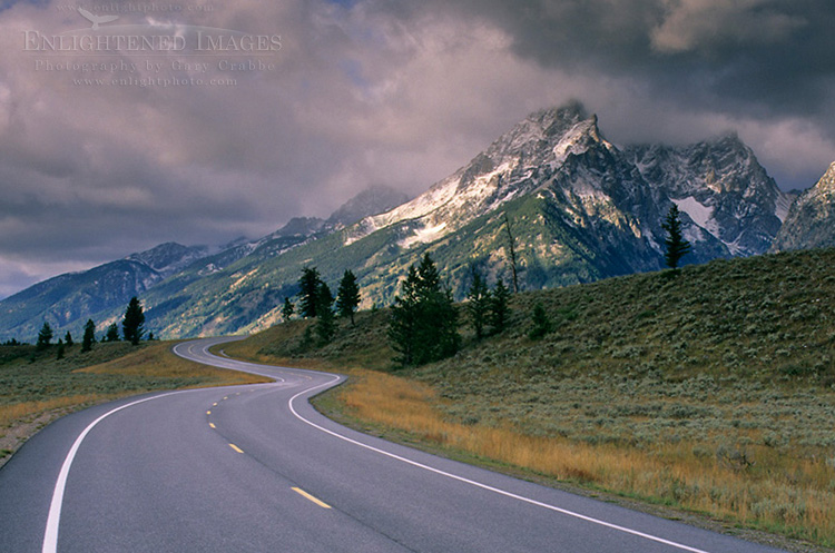 Image: Curving road below mountain range dusted by first snow of fall, Grand Teton National Park, Wyoming