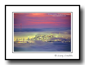 City skyline and lights of San Francisco in fog at sunset, California