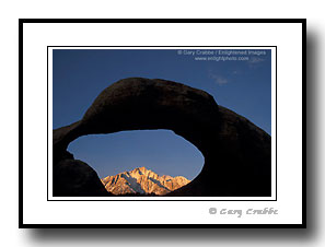 Arch rock over mountain peak in Eastern Sierra, Alabama Hills, Lone Pine, California