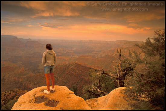 Picture: Female tourist overlooking the Grand Canyon at sunset, Grand ...